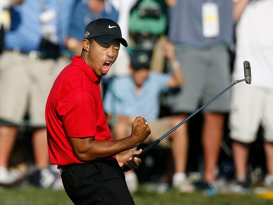 Tiger Woods celebrates after making a birdie on the 18th green to tie Rocco Mediate for the lead and force an 18 hole playoff at the final round of the 2008 US Open Championship at Torrey Pines. (via Golfweek)