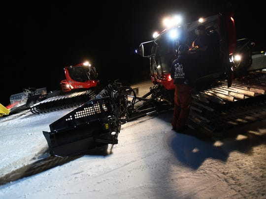 Grooming Supervisor Russ Mitchell, in cab, talks with fellow groomer JP Silva while working through the night at Diamond Peak Ski Resort near Incline Village on March 6, 2015.