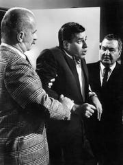 Jerry Lewis, center, is restrained by Keenan Wynn and