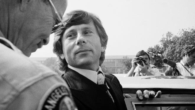 In this Oct. 25, 1977, file photo, film director Roman Polanski leaves court in Santa Monica, Calif. Roman Polanski lost his latest bid to have a California court dismiss his 1977 sex case when a judge rejected a motion for a new hearing.