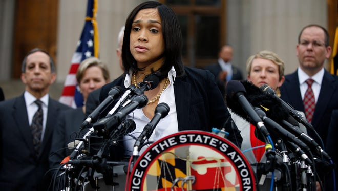 Prosecutor Marilyn Mosby announces criminal charges against six officers in the death of Freddie Gray in Baltimore on May 1.