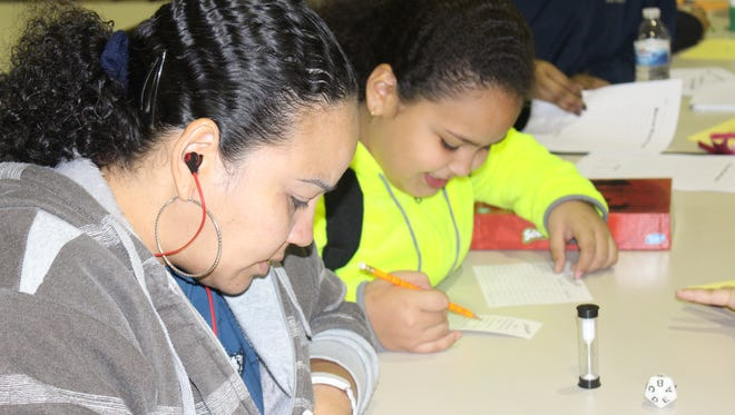 Joangelly Rodriguez and her mother, Marilyn Rivera, play Scattergories during Family Literacy Night at Quarter Mile Lane School in Bridgeton.