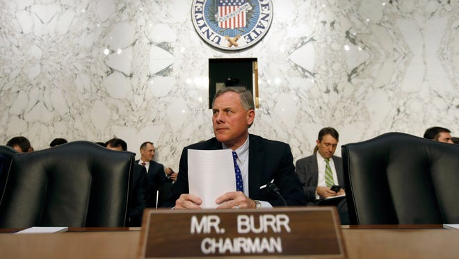 Chairman Sen. Richard Burr, R-N.C., prepares before the Senate Intelligence Committee's hearing on worldwide threats Feb. 9 in Washington.