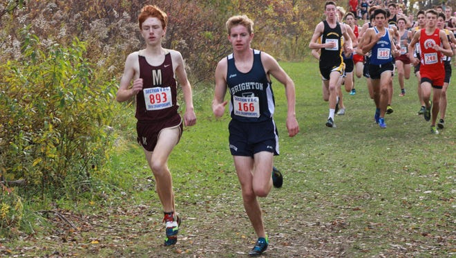 Pittsford Mendon's Nathan Lawler, right, the eventual Class B champion, goes stride for stride with runner-up Paul Dellinger of Brighton.