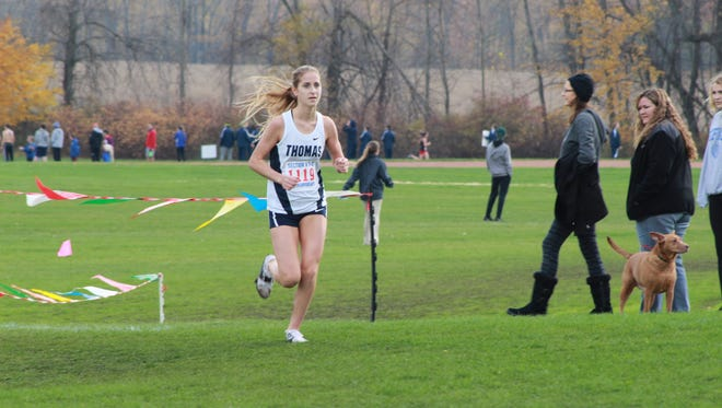 Amanda Vestri races to the Class A individual title and her Webster Thomas team also won.