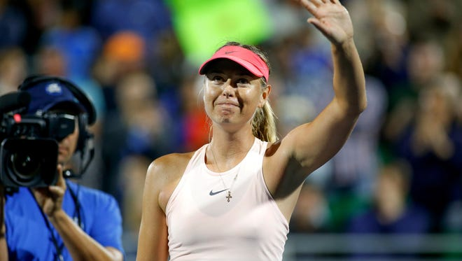 Maria Sharapova (RUS) waves to the crowd after winning against Jennifer Brady (USA) in the Bank of the West Classic tennis tournament at Stanford University.