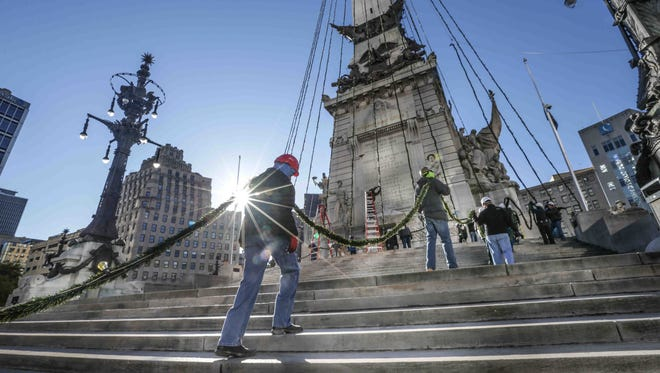 At the Indiana Soldiers and Sailors Monument, 200 IBEW No. 481 union electricians string the 4,784 lights for Downtown Indy, Inc.'s Circle of Lights presented by IBEW #481, Saturday, Nov. 12, 2016.