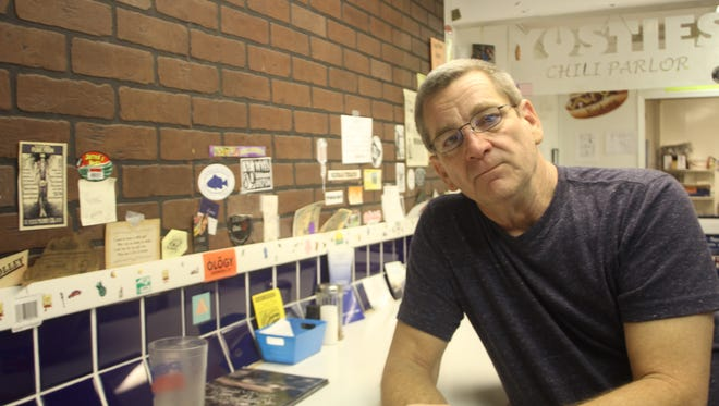 Gary Yost sits inside Yostie's Railroad Ave. location Thursday, a day before its closing. Yost is looking to re-open the restaurant in another space in the immediate area.
