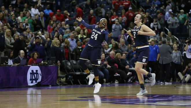 Mar 30, 2018; Columbus, OH, USA; Notre Dame Fighting Irish guard Arike Ogunbowale (24) and guard Marina Mabrey (3) celebrate their upset win over the Connecticut Huskies in overtime in the semifinals of the women's Final Four in the 2018 NCAA Tournament at Nationwide Arena. Mandatory Credit: Joseph Maiorana-USA TODAY Sports