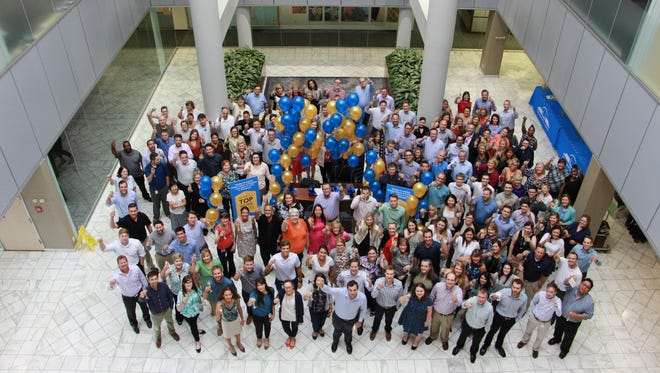 The Phillips Edison & Company team celebrates its Top Workplaces award.