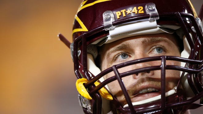 Arizona State quarterback Taylor Kelly watches the action before the game against Stanford on Saturday, Oct. 18, 2014 at Sun Devil Stadium in Tempe.