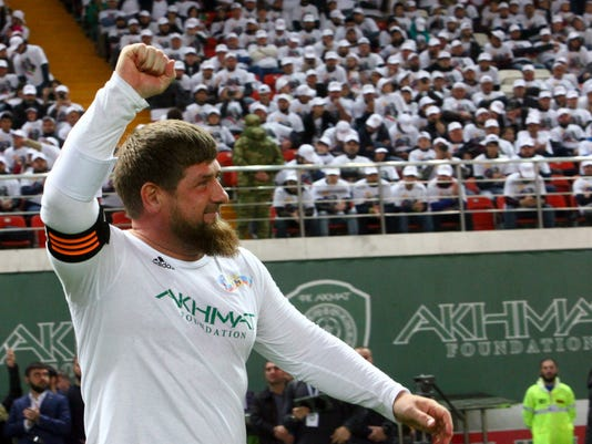 FILE - This is a Saturday, Oct. 7, 2017 file photo of Chechnya's regional leader Ramzan Kadyrov celebrates scoring against the Italian former players soccer team in Grozny, Russia. Egypt will be based at the World Cup in Chechnya with FIFA approving the facility despite the Russian region's leadership being criticized for widespread human rights violations and a crackdown on dissent. Egypt has selected a training facility in the Chechen capital Grozny for its first World Cup trip in 28 years. (AP Photo/Musa Sadulayev)