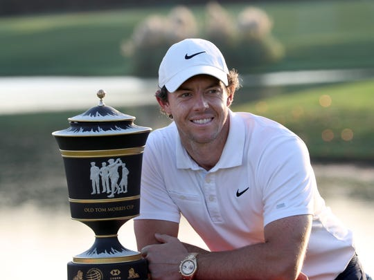 Rory McIlroy of Northern Ireland poses with the trophy after winning the HSBC Champions golf tournament at the Sheshan International Golf Club in Shanghai on Sunday, Nov. 3, 2019. (AP Photo/Ng Han Guan)