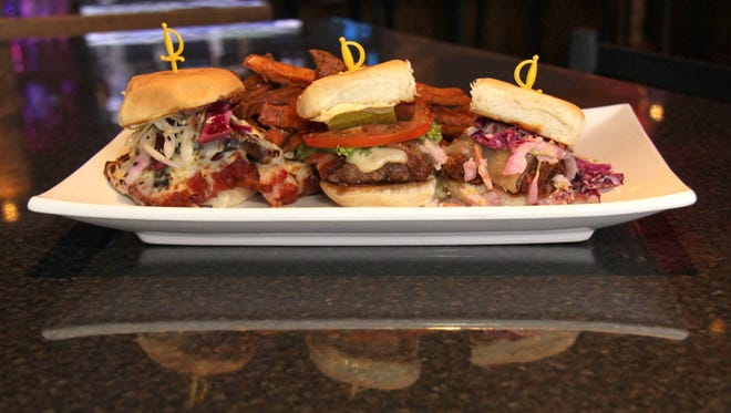 Three sliders (from left): the Pork Belly, burger and pulled pork.