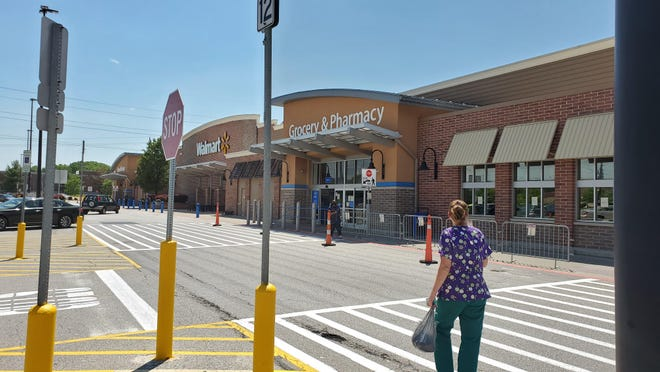 A Macedonia Walmart employee tells a shopper Tuesday that the store is closed.