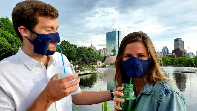 Kiley Merrill and Parker Greiwe show off a new mask that can open and close while people are eating. The Your Social Mask was developed by Jennifer and Bob McMahon of Martha's Vineyard.