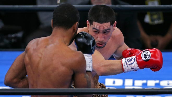Danny Garcia punches Lamont Peterson at Barclays Center.