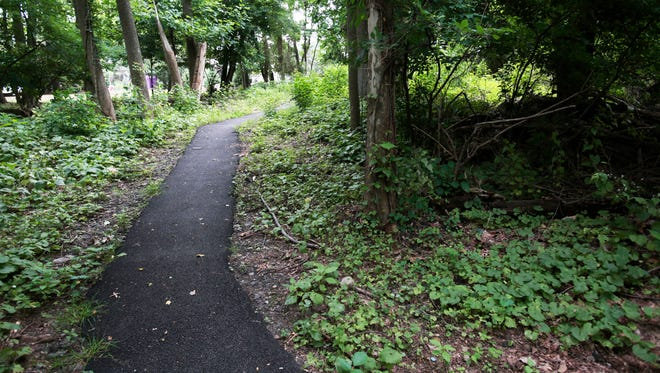 The illegal 300-foot walkway created on town property continues to exist connecting 1 Neva Court to 9 Quince Lane in Suffern on July 14, 2015.