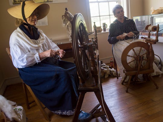 Beverly Sanders, left and Viginia Christmas spin wool during Colonial Day on Saturday June 18, 2016 at the State Historic Fort Loudoun.