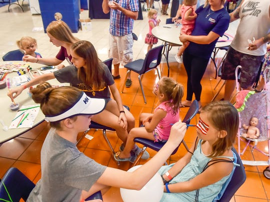 Children get their faces painted during ChambersFest: