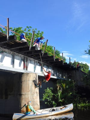 On June 29, volunteers on land and in canoes cleaned up graffiti on the railway bridge over the Estero River. Volunteers will again gather for a National Public Lands Day cleanup Sept. 24.