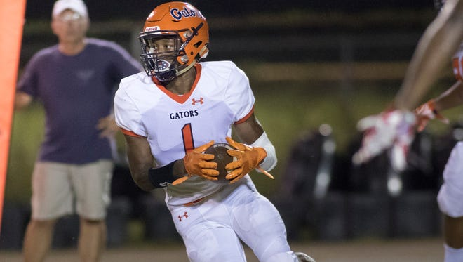 Jacob Copeland (1) looks for open field during the Escambia vs West Florida high school football game in Pensacola on August 24.