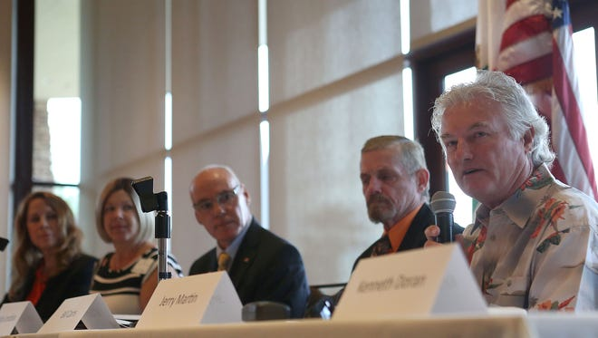 Jerry Martin, right, speaks during the Palm Desert Chamber of Commerce city council candidate forum, Tuesday, October 7, 2014.