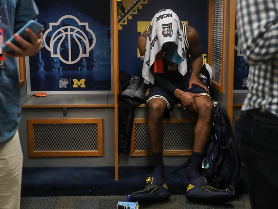 Michigan guard Zavier Simpson sits in the locker room