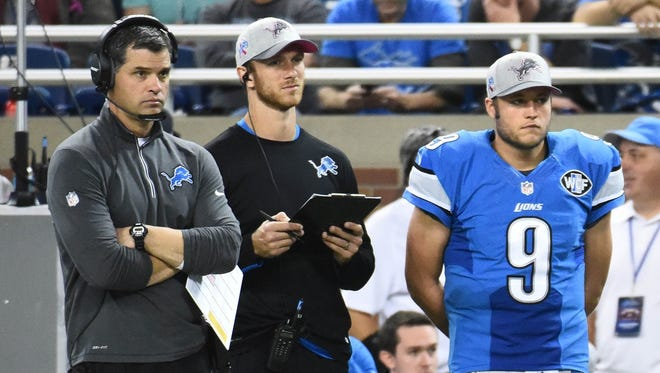 Detroit Lions offensive coordinator Joe Lombardi, left, and quarterback Matthew Stafford, right, watch the fourth quarter against the Arizona Cardinals at Ford Field.