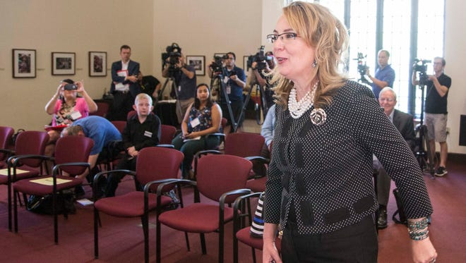 Former Congresswoman Gabrielle Giffords prepares to announce the Arizona Coalition for Common Sense at the Heard Museum in Phoenix on March 16, 2017.