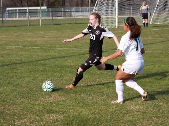 Lakeview's Marina Puhalj gets the ball out of the Lakeview
