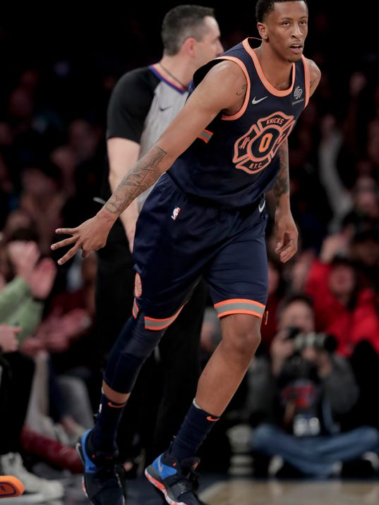 New York Knicks forward Troy Williams (0) reacts after scoring a three-point basket against the Charlotte Hornets during the second quarter of an NBA basketball game, Saturday, March 17, 2018, in New York. (AP Photo/Julie Jacobson)