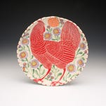 Sue Tirrell's pottery and sculpture is known for bright colors on a white background.