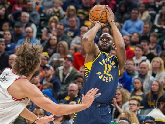 Pacers guard Damien Wilkins (12) shoots the ball while