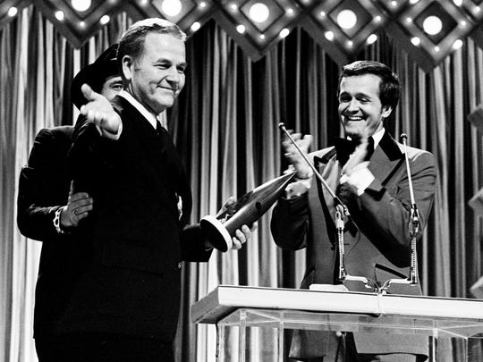 Presenters Bobby Bare, left, and Bill Anderson, right,