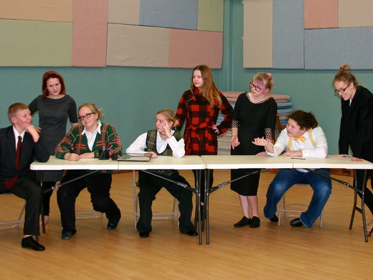 Office staff members react to Walter Hobbs' joke. Students around the conference table (from left) are Collin Lukes, Emily Schaller, Madison Moore, Allyson Stokes, Addison Fowler, Maya Gadzinski, Cat Seiler and Alexandria Decker.