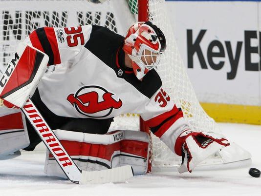 636432542289906378-Devils-Sabres-Hockey-njha-10-.jpg