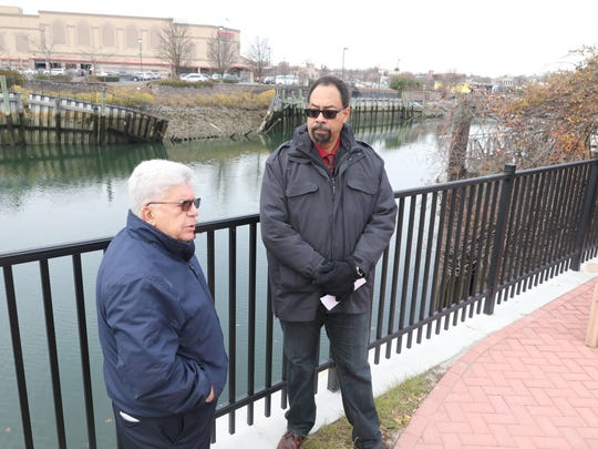 From left, Port Chester Mayor Richard Falanka and Village Manager Christopher Steers across from the Byram River bulkhead at the Costco store.