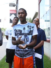 Ase Strawter, 18, center, speaks to the media about his friend Eriaun Warrick, a Western Kentucky University student, being shot at a party in Louisville early Sunday morning.  He was joined by, from left; Britney Duncan, 19, Joshua Shannon, 19,  Christopher 2X and Sasha Snardon, 19. May 30, 2016