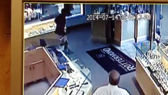 A defense attorney said Monday that he will seek a new trial for his client who was convicted of robbing the Rottermond's Family Jewelry store on Main Street in downtown Brighton in 2014 after this video was released from the store. The attorney says the video shows the suspects did not have a weapon in their hand as a witness testified at trial.