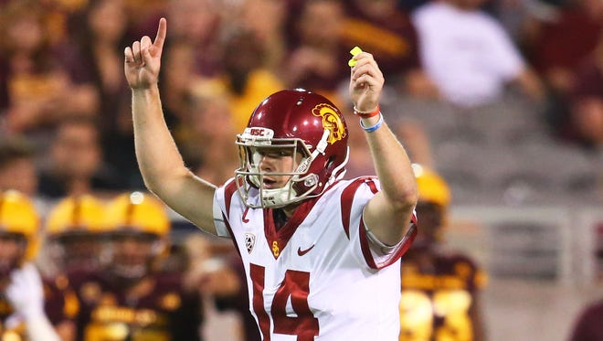 Southern California Trojans quarterback Sam Darnold (14) celebrates a play in the second half against the Arizona State Sun Devils at Sun Devil Stadium.