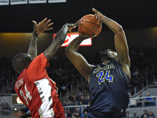 Nevada's Jordan Caroline gets a shot blocked by UNLV's