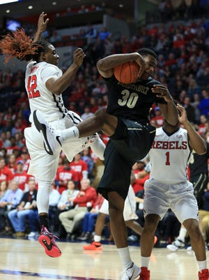 Vanderbilt center Damian Jones (30) grabs the rebound against Ole Miss guard Stefan Moody (42) on Feb. 6, 2016.