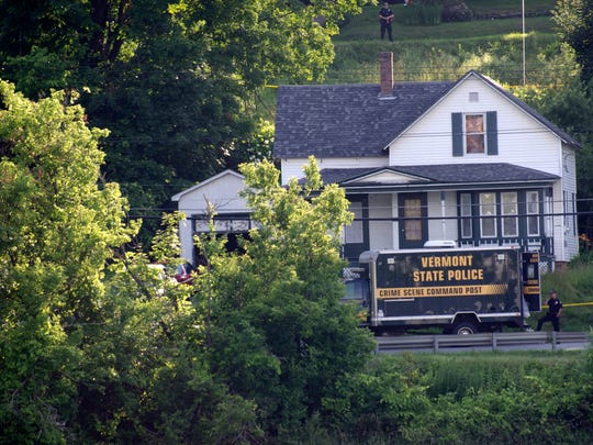 Vermont State Police command near the crime scene of 123 Lake Road in Newport, where a man died Saturday.