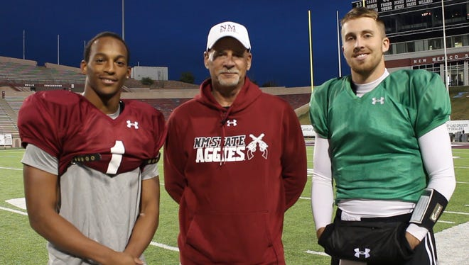 New Mexico State University football head coach Doug Martin, center, senior running back Larry Rose III, left, and senior quarterback Tyler Rogers join forces to bring in support for the Football Success Fund aimed at recruiting top talent and meeting team needs to continue NMSU Aggie Football success.