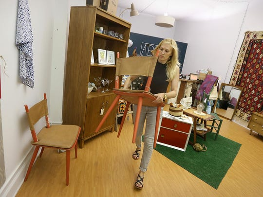 Amanda DeFisher, co-owner of Abode, works in her city shop.