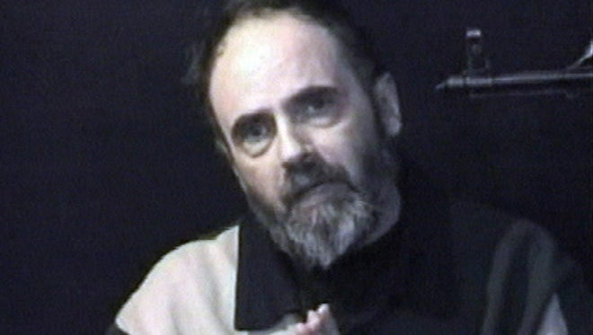 In this image taken from insurgents video released on Tuesday Jan. 25, 2005  American Roy Hallums pleads for Arab rulers to intercede to spare his life. Hallums, 56, was seized Nov. 1 along with Robert Tarongoy of the Philippines during an armed assault on their compound in Baghdad's Mansour district in Iraq.