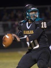 Navajo Prep quarterback Justin Cly prepares to throw
