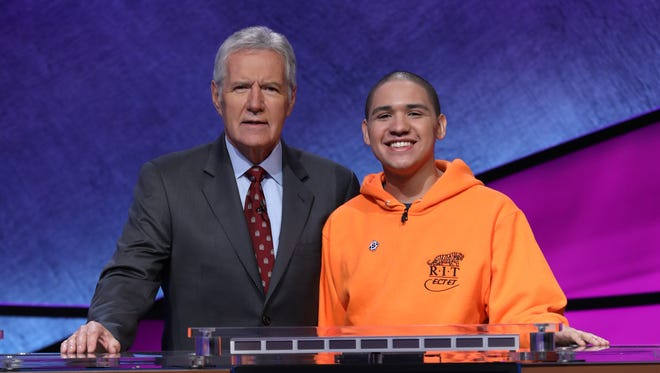 """Sheldon Lewis, a sophomore at Rochester Institute of Technology, poses with Alex Trebek, the host of """"Jeopardy!"""""""