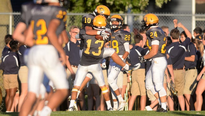 Grand Ledge's Zach Willoughby (10) celebrates his touchdown with Nolan Bird (13) during the Grand Ledge vs. DeWitt football game on Thursday, Sept. 1, 2016 at Grand Ledge High School.